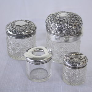 Four Antique English Hallmarked Silver Lidded Vanity Jars