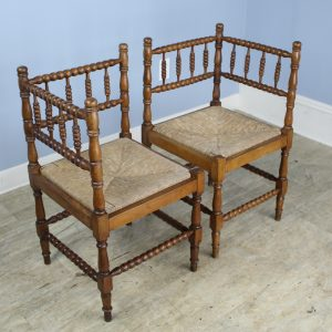 Pair of French Bobbin Carved Fruitwood Corner Chairs